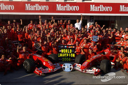 Ferrari team members celebrate 2004 Constructors World Championship