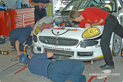 Scuderia Ferrari of Washington crew members at work