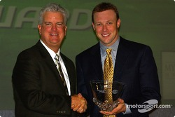 Matt Kenseth receives the Waste Management Award during the Myers Brothers breakfast