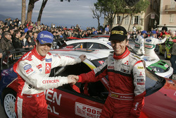 Winner Sébastien Loeb celebrates with Gilles Panizzi