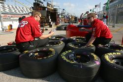 Bud Chevy crew members prepare wheels