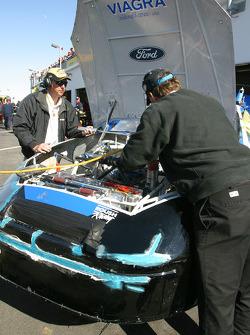 Viagra Ford crew still at work on the damaged #6 car of Mark Martin