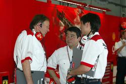 Practice preparations inside Ferrari garage area