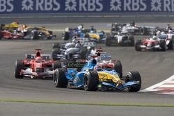 First corner: Fernando Alonso leads Michael Schumacher
