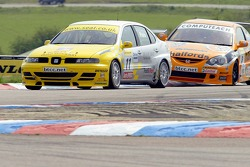 #8 Dan Eaves of Team Halfords tries to pass #11 Seat Sport UK Seat Toledo Cupra of Jason Plato