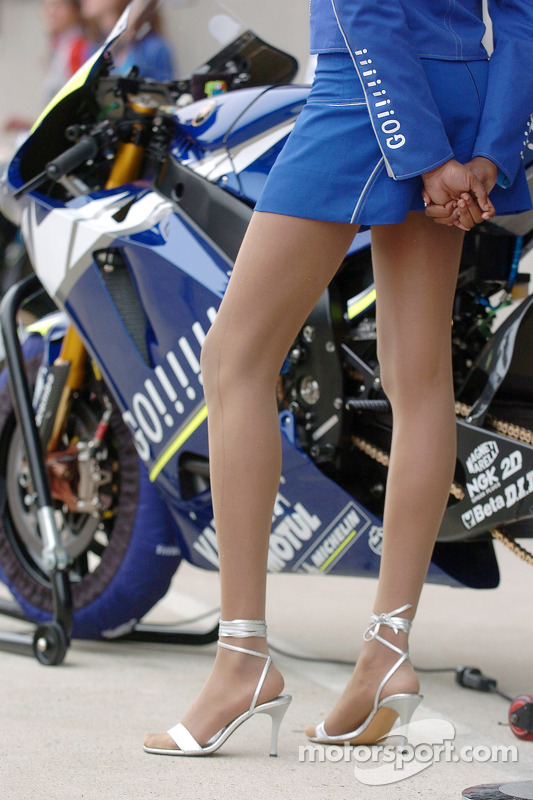 Bike of Valentino Rossi with an umbrella girl at French GP