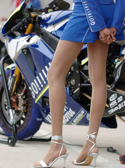 Bike of Valentino Rossi with an umbrella girl