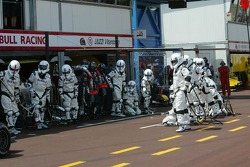 Red Bull Racing Stormtroopers wait for David Coulthard
