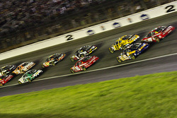 The pack heads into turn 2