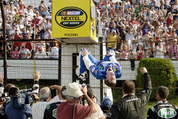 Victory lane: race winner Carl Edwards celebrates with his usual backflip