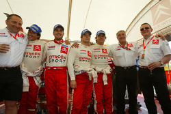 Winners Sébastien Loeb and Daniel Elena celebrate with Carlos Sainz and Marc Marti and Citroën Sport team members