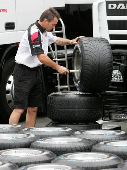 BAR-Honda team member prepares tires