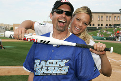 Jennie Finch of the Chicago Bandits softball team puts the squeeze on Kyle Petty before the Racin' the Bases Celebrity Softball game benefitting the Victory Junction Gang Camp