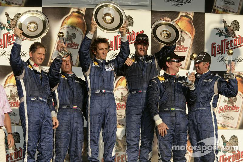 Ganador de la carrera Alain Prost con Jody Scheckter, Johnny Cecotto, Nigel Mansell, Emerson Fittipaldi y Mick Doohan