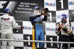 Podium: champagne for Fernando Alonso, Juan Pablo Montoya and Jenson Button