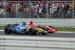 Giancarlo Fisichella passes Michael Schumacher