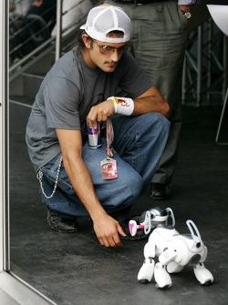 Vitantonio Liuzzi plays with a Sony Aibo robot dog