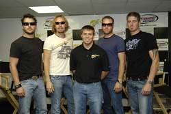 Scott Riggs stands with members of rock band Nickelback Daniel Adair, Chad Kroeger, Mike Kroeger and Ryan Peake as they speak to the media during a press conference