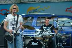 Rock band Nickelback performs on the infield before the race