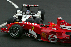 Michael Schumacher and Takuma Sato crash