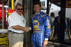 Bill David and Michael Waltrip shake hands during a press conference held to announce their one-year deal