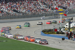 Kevin Harvick leads the field onto pit road