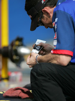 GP Brawny Dodge crew member prepares wheels