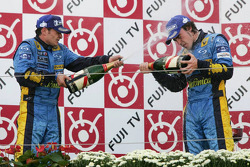 Podium: champagne for Giancarlo Fisichella and Fernando Alonso