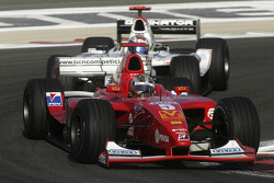 Ernesto Viso leads Nico Rosberg