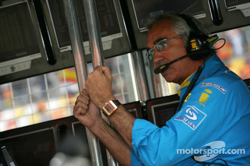 Flavio Briatore celebrates as Fernando Alonso takes the pole position