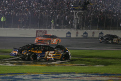 Michael Waltrip spins in the grass