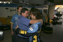 Fernando Alonso celebrates with Patrick Faure