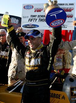 Race winner Tony Schumacher celebrates