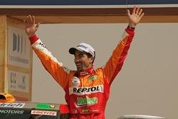Car category podium: winner Luc Alphand celebrates