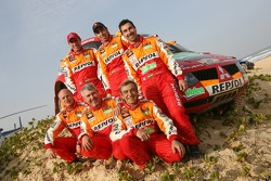 Team Repsol Mitsubishi Ralliart drivers and co-drivers Nani Roma, Henri Magne, Stéphane Peterhansel and Jean-Paul Cottret celebrate with car category winners Luc Alphand and Gilles Picard