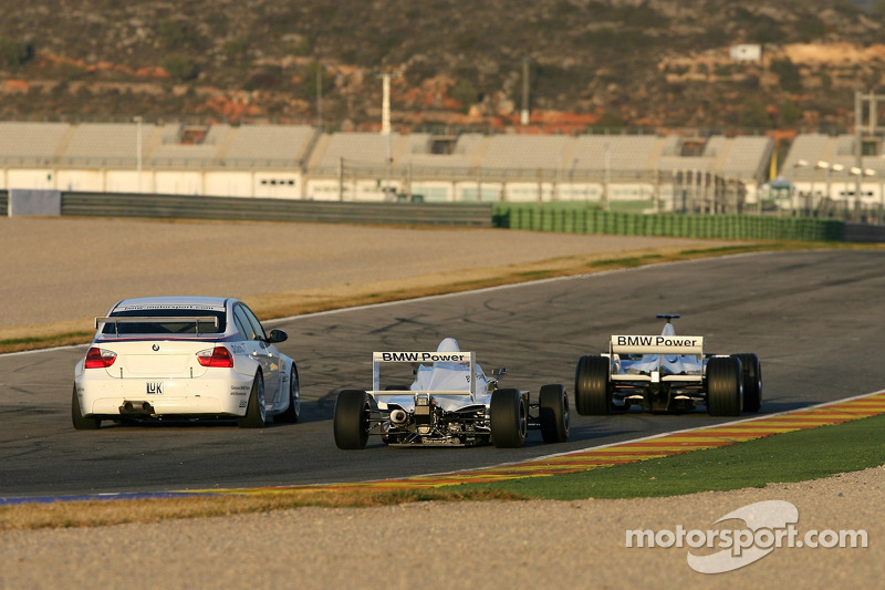 Nick Heidfeld in the BMW Sauber F1.06, Jorg Muller in the BMW 320si WTCC, Robert Kubica in the BMW 802