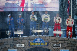 Podium: winners Marcus Gronholm and Timo Rautiainen with second place Sébastien Loeb and Daniel Elena and third place Daniel Carlsson and Mattias Andersson
