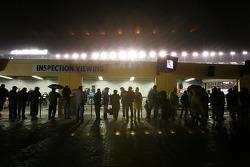 Fans watch tech inspection under the rain