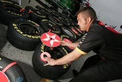 Havoline Dodge crew member prepares tires