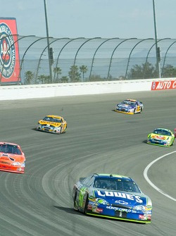 Jimmie Johnson in the Lowes car fights off a pack of cars through Turn 2