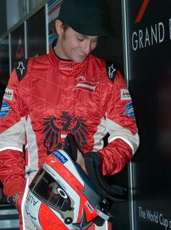 Mathias Lauda, driver for Team Austria, is weighed with his helmet at the scrutineering garage
