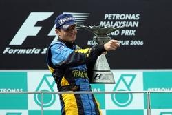 Podium: race winner Giancarlo Fisichella celebrates