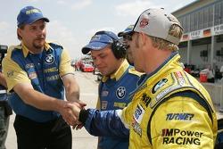 Race winner Bill Auberlen celebrates with his crew