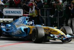 Race winner Fernando Alonso enters Parc Fermé