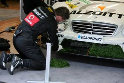 Mechanics clean the car of Jamie Green