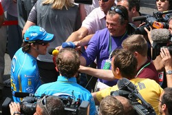 Fernando Alonso talks with the media
