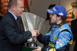 Podium: Race winner Fernando Alonso is congratulated by Prince Albert of Monaco