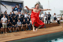 Red Bull Racing sporting director Christian Horner makes good  on a bet that if the team made the podium, he would jump naked into the team pool