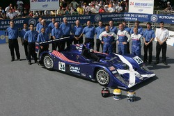 Bill Binnie, Allen Timpany, Yojiro Terada and the Binnie Motorsports Team pose with the Binnie Motorsports Lola 05/42 Zytek