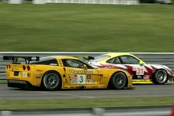 #31 Petersen/White Lightning Porsche 911 GT3 RSR: Jorg Bergmeister, Michael Petersen, Patrick Long, #3 Corvette Racing Corvette C6-R: Ron Fellows, Johnny O'Connell